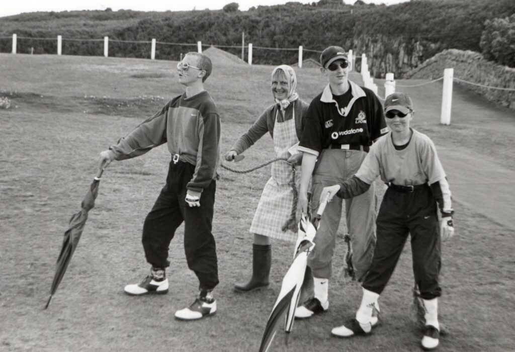 Farmers wife, Sheila Gray (Brodick ladies open champion) with three blind mice at the August Texas Scramble at Shiskine.