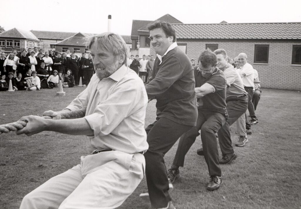 Mr Miller leads the tug-o-war against the senior boys in the staff versus pupils competition at the Arran High School's sports day.