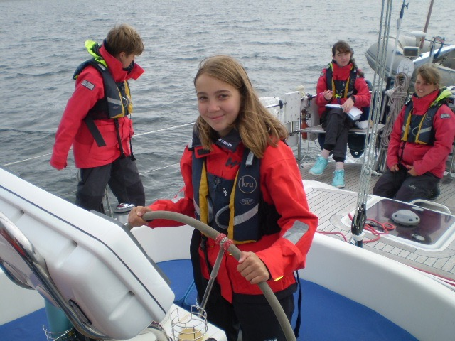 Young sailors have a chance at the helm.