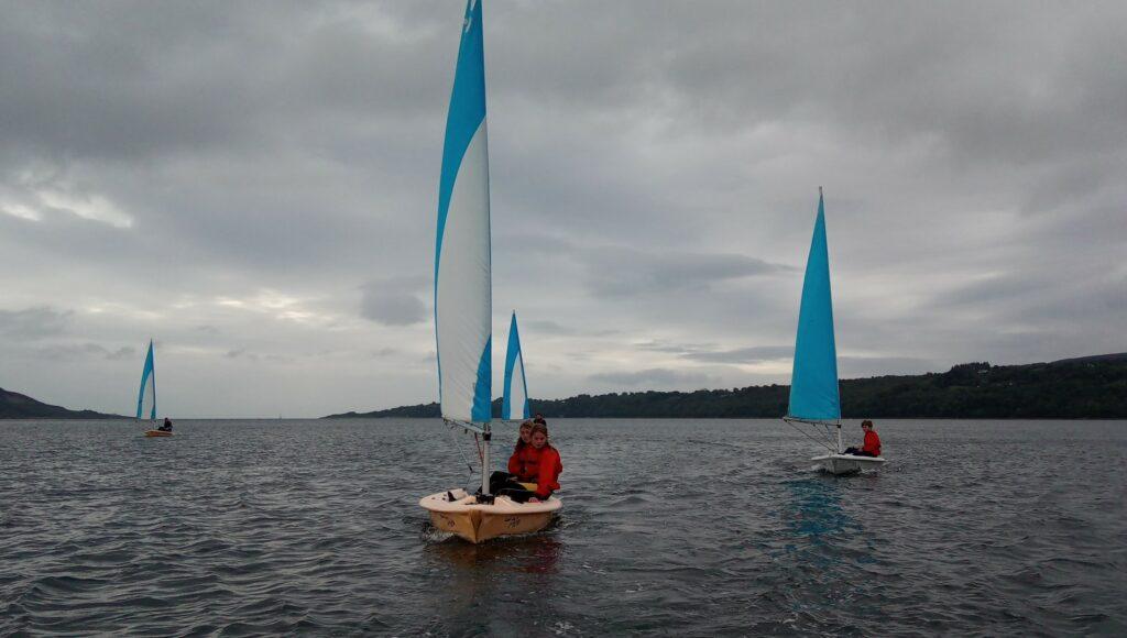 Pico dinghy sailing in Lamlash Bay.