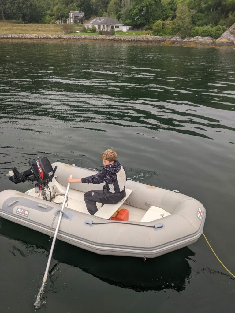 A young boy concentrates on his rowing skills.