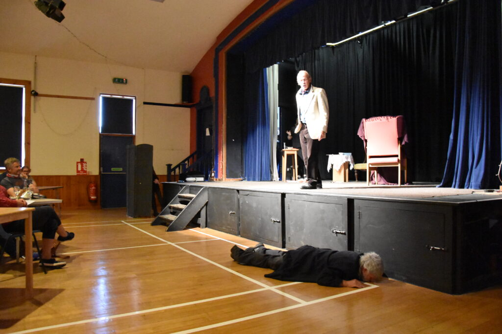 A 'drunk' Allan Nicol falls off the stage and leaves David Simpkin aghast.