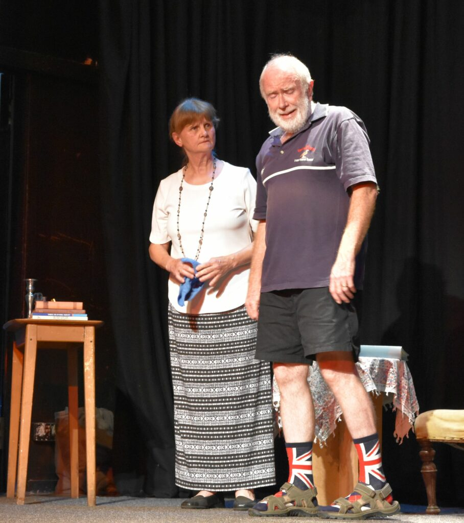 Where did he come from? Her 'dead' husband appears from behind the chair.