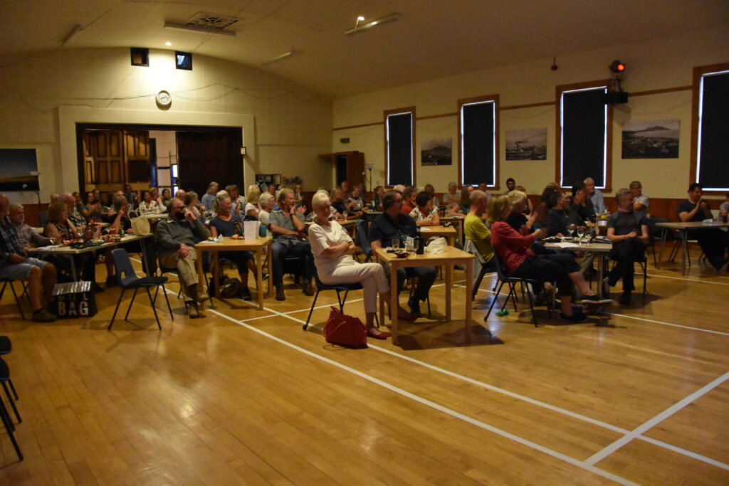 A packed Whiting Bay hall laps up the performance.