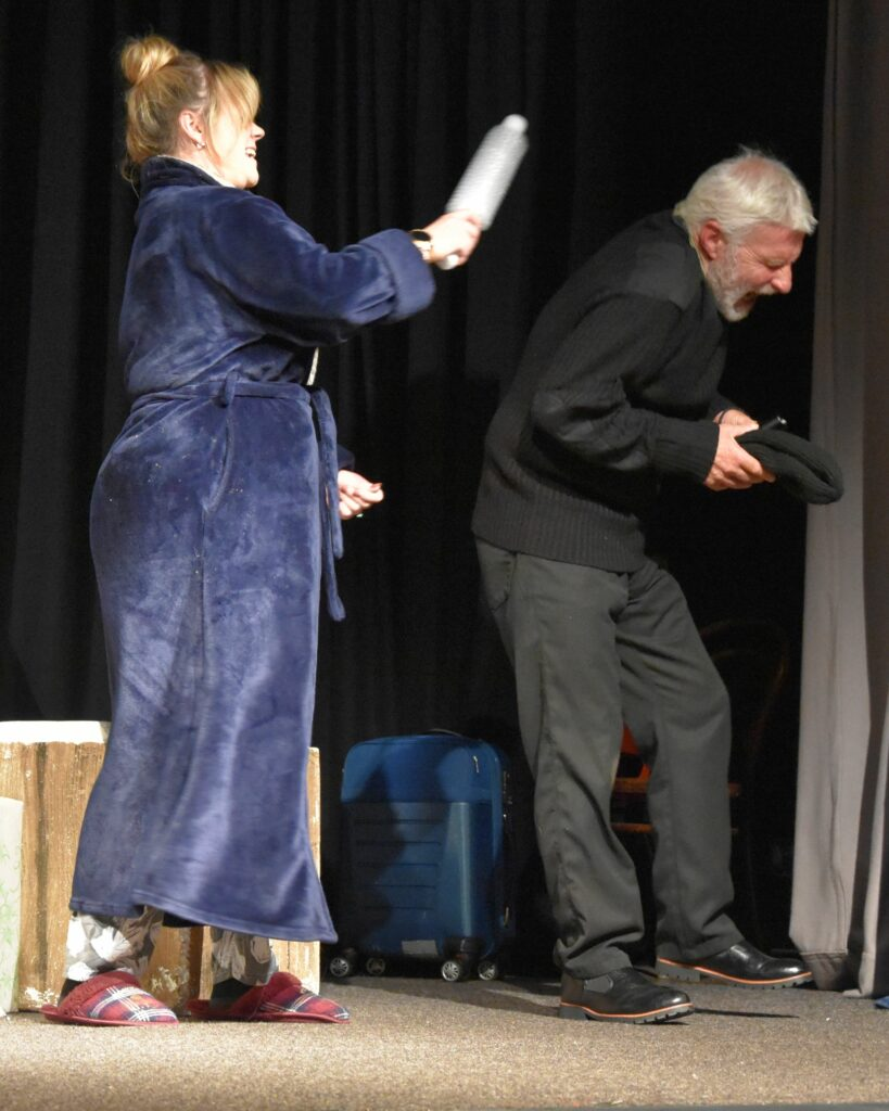 The daughter in Family Secrets, Stacey Gordon, takes it out on burglar Allan Nicol.