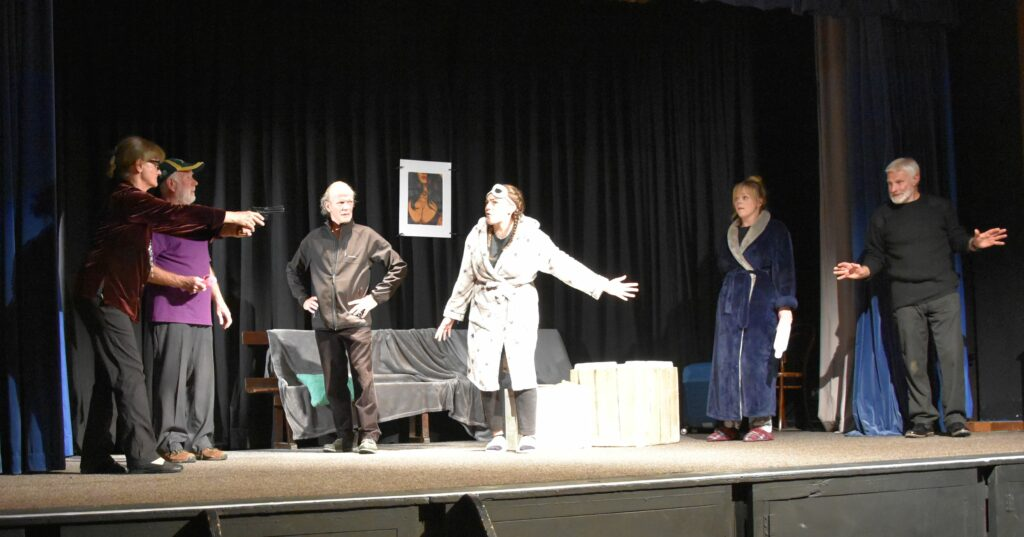 A dramatic scene as the found out Mrs Scott pulls a gun on the gathering.