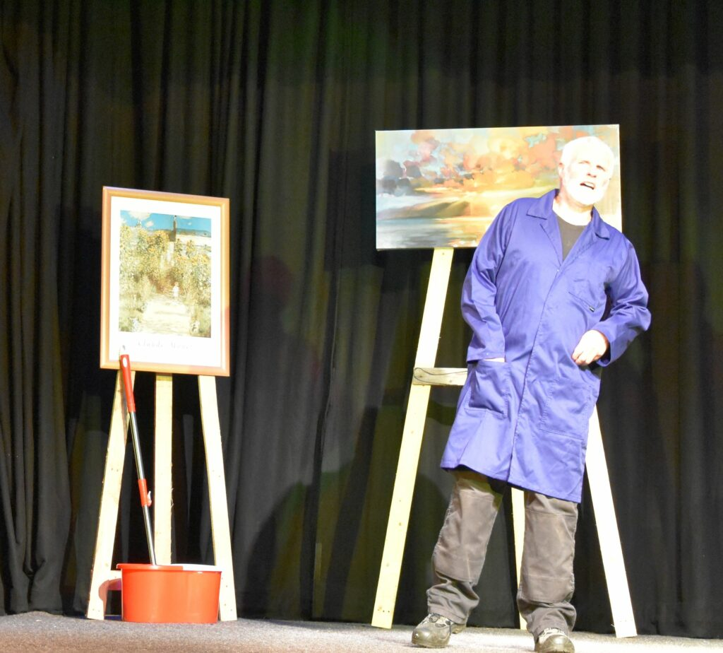 Janitor Allan Nicol takes in the comments about the painting.