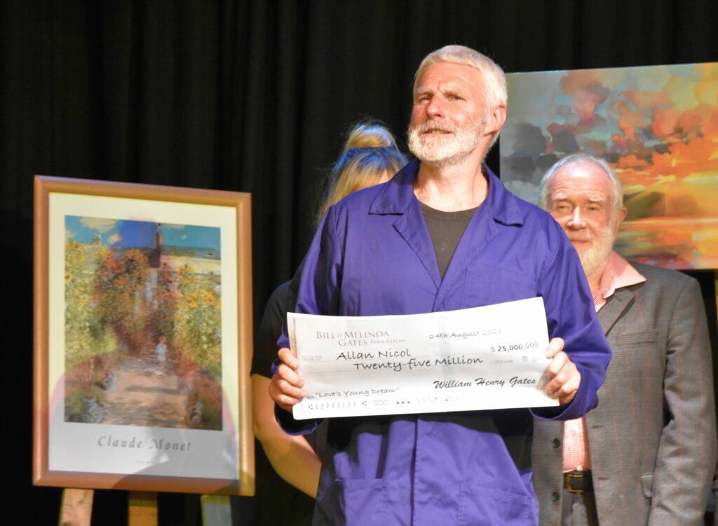Allan Nicol shows off the $25 million cheque for his masterpiece.