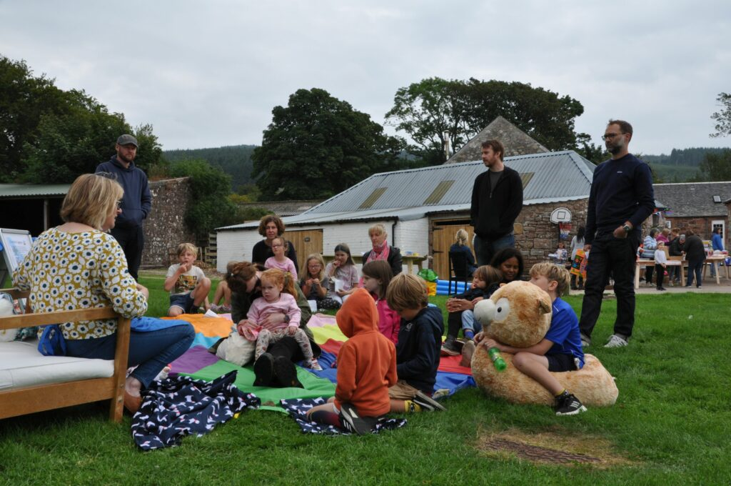 Arran author Alison Page reads her latest book to young children who listen intently.