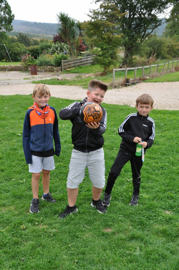 Young footballers pose for the camera.