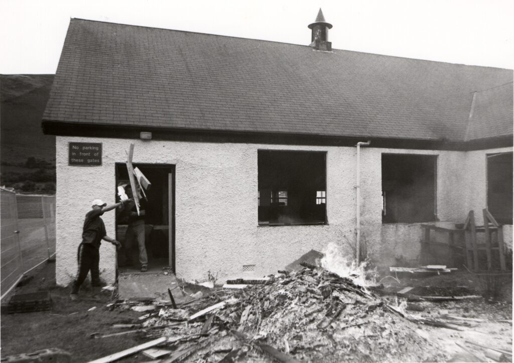 The old Lochranza hall will soon be no more as demolishers have beeb taking it to bits before bulldozing the walls.