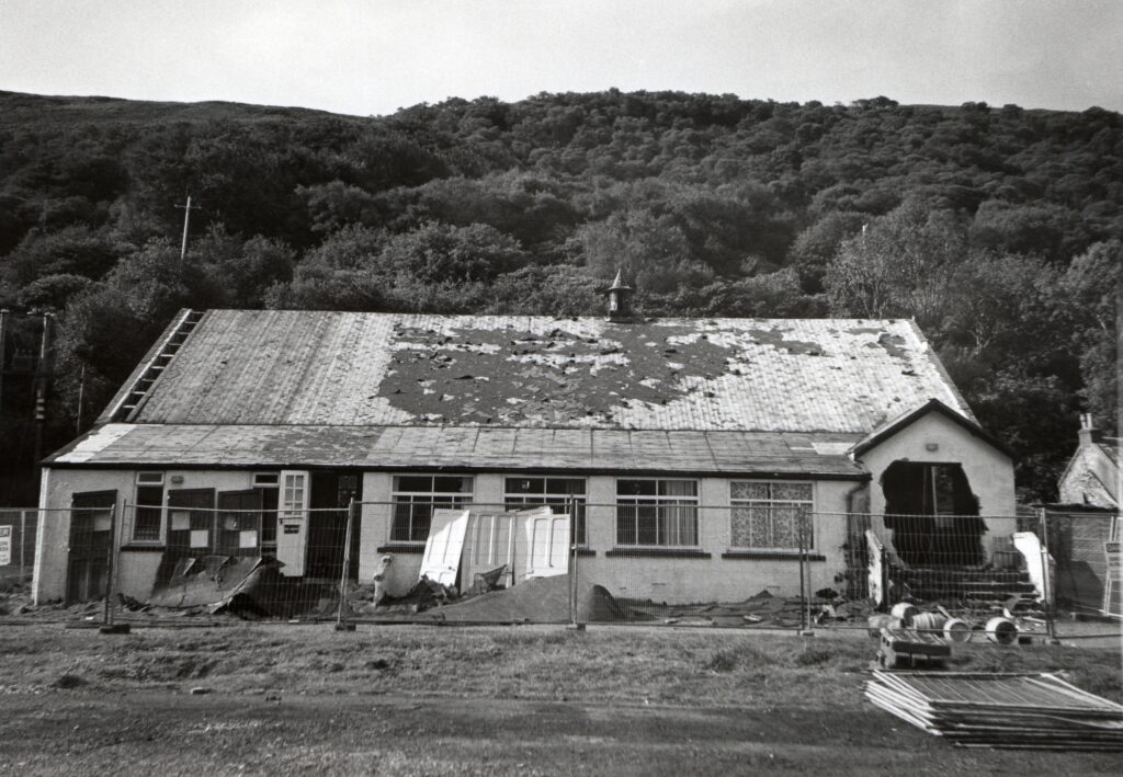 The old Lochranza Hall finally came down this week. Having been stripped the previous week the bulldozers moved in, leaving an open space behind the new hall which was opened last Easter.