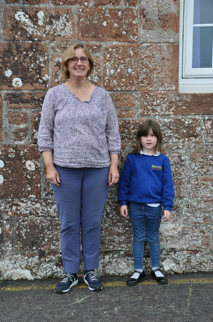 Mrs Diana Dunn with her P1 pupil at Shiskine Primary.