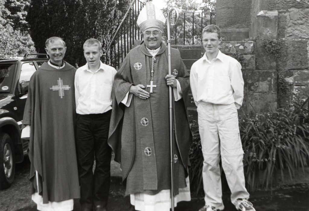 Paul Tinto of Lamlash and Ashley Roberts of Whiting Bay were confirmed into the Roman Catholic faith recently. A celebratory mass at Holy Cross Church in Brodick was attended by the Bishop of Argyll and the Isles, Ian Murray. Also pictured is Father Noel Colford of the Holy Cross Church.