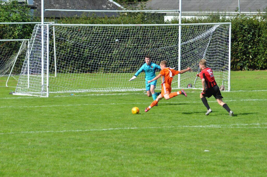 Kieran Rae scores an early goal for Arran.