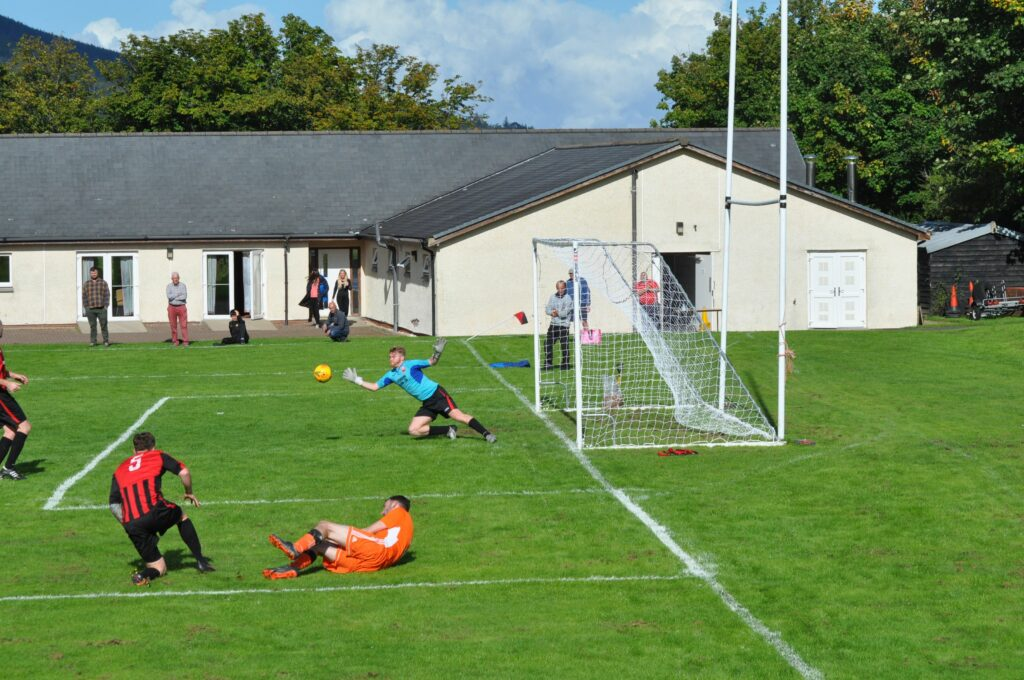 The Drumchapel keeper at full stretch to make a save.