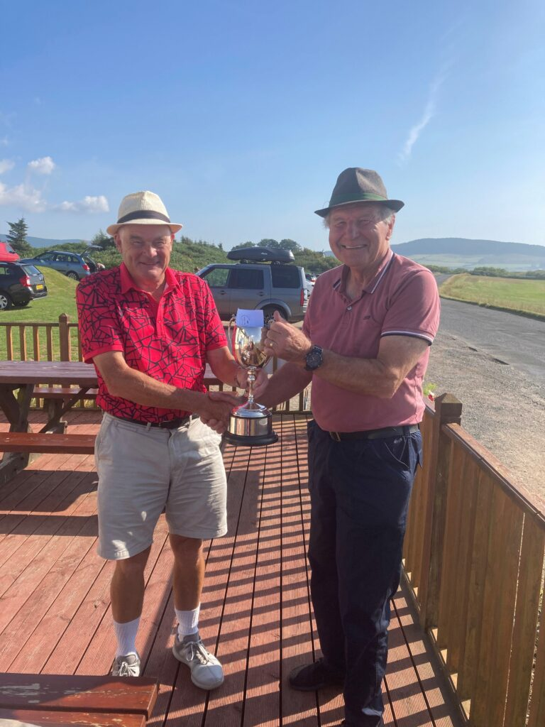 Machrie Bay's Brian Sherwood presents Campbell Laing with the Lawson-Cameron trophy.