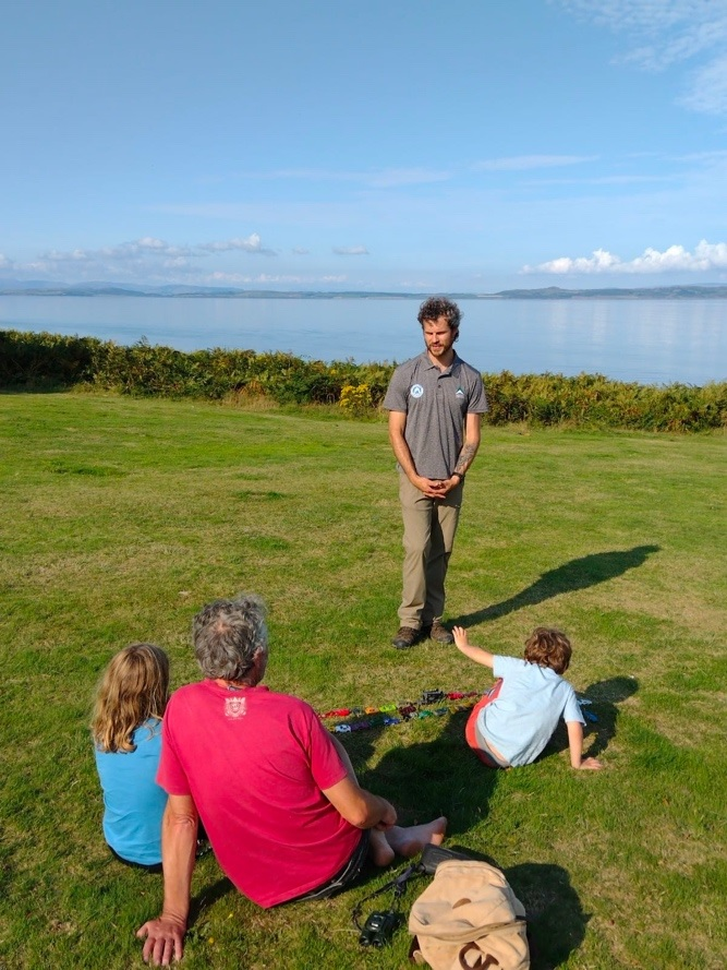 New access ranger Alex Rose engages with a family visiting the island.