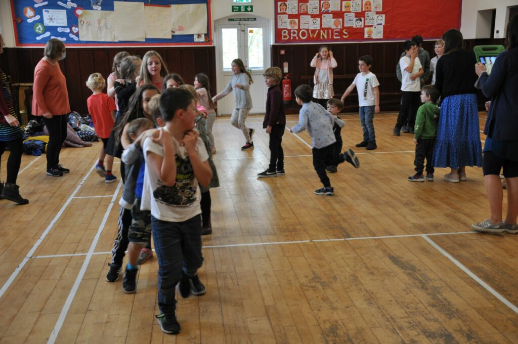 Children enjoy games and activities at Barbara's leaving party in Shiskine Hall.