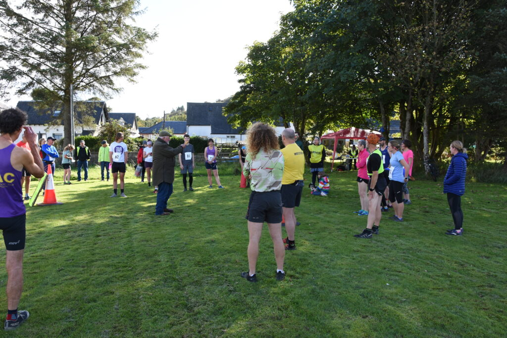 Derek Shand gives a briefing to runners ahead of the race.