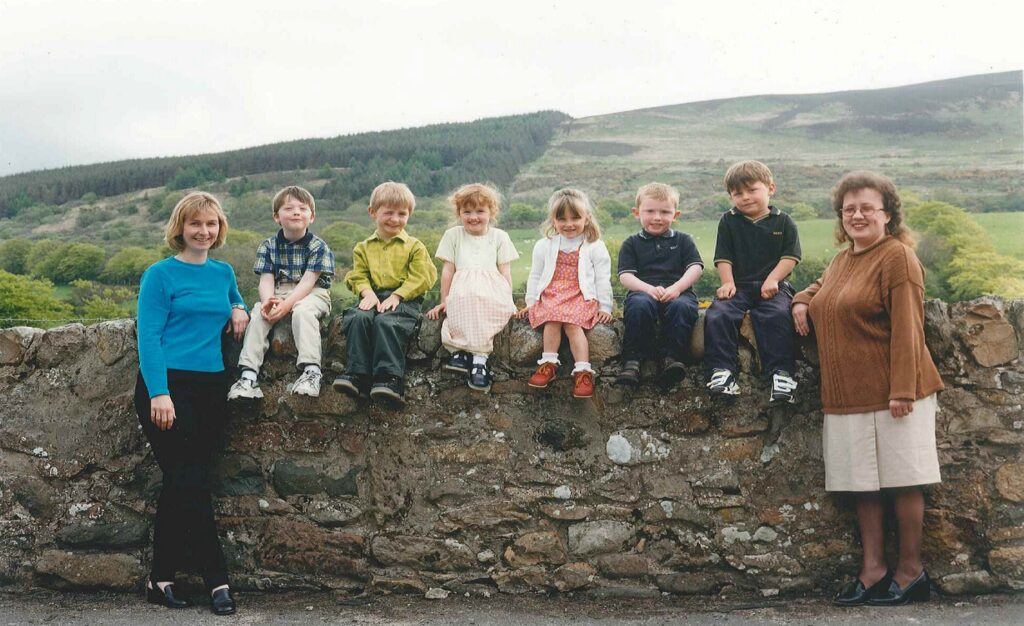 Barbara is pictured with Mairi Duff and the very first nursery class at Shiskine in 1998, before the purpose built nursery opened two years later.