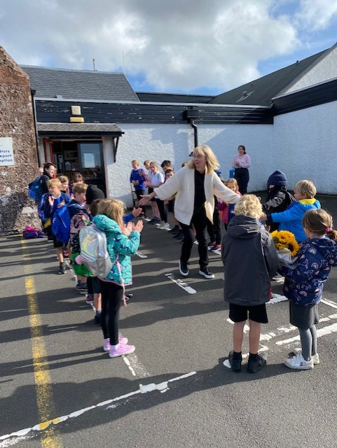 Pupils say goodbye to Barbara on her final day at Shiskine Primary.