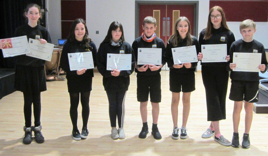 Pupils receive their achievement awards