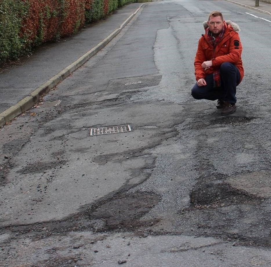 Drivers urged to report potholes