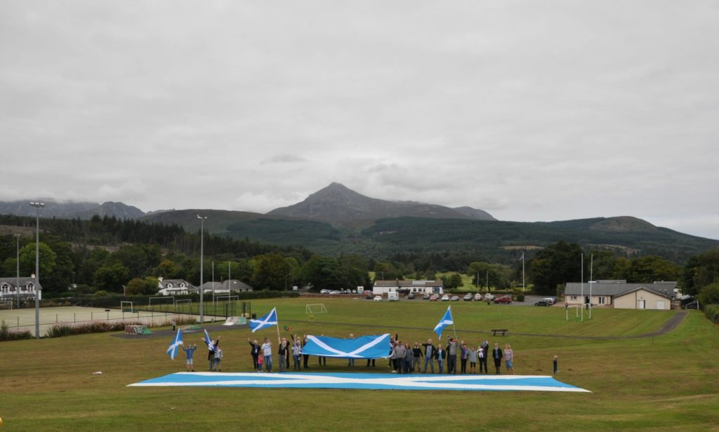 Giant saltire flag visits Arran during nationwide tour