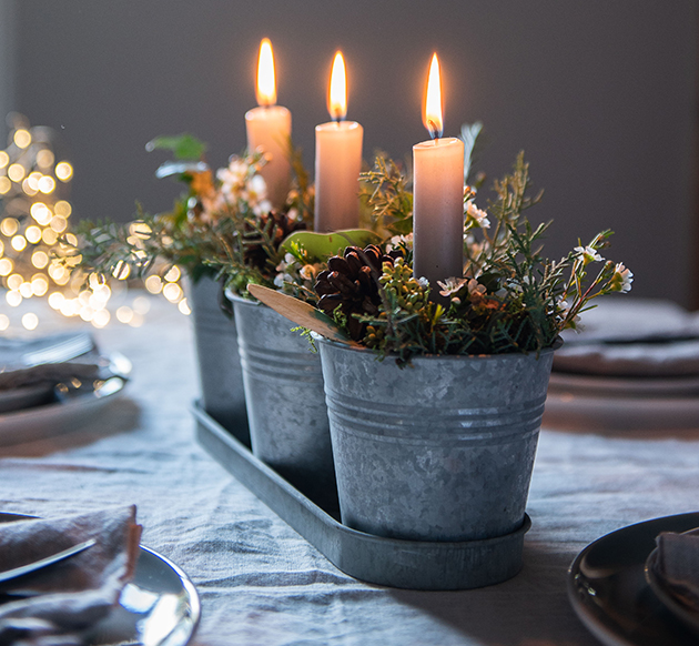 Candle and foliage table centre
