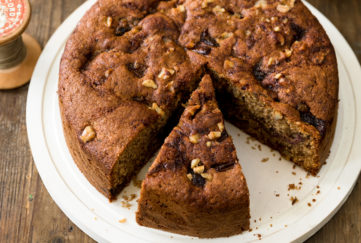 Rich, moist, spongy date and walnut cake, 2 slices cut