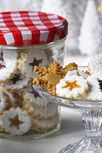 Linzer Cookies, Bonne Maman mini festive treats. Jam sandwich biscuits with a small shape cut out of the top biscuit showing the jam