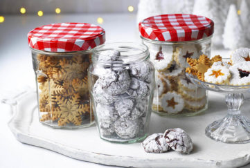 3 jars of Bonne Maman tiny festive biscuits and some on a cake stand