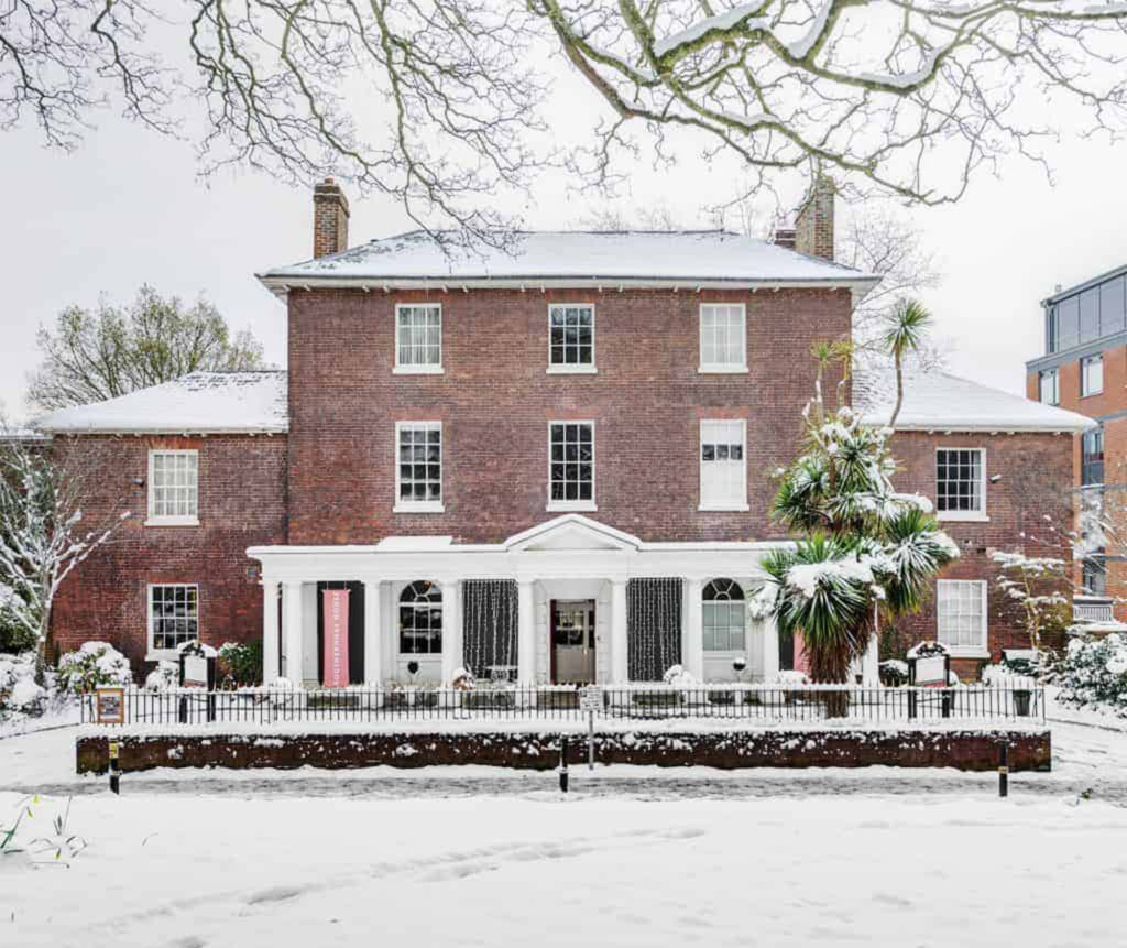 Exterior of Georgian 3 storey brick house in the snow