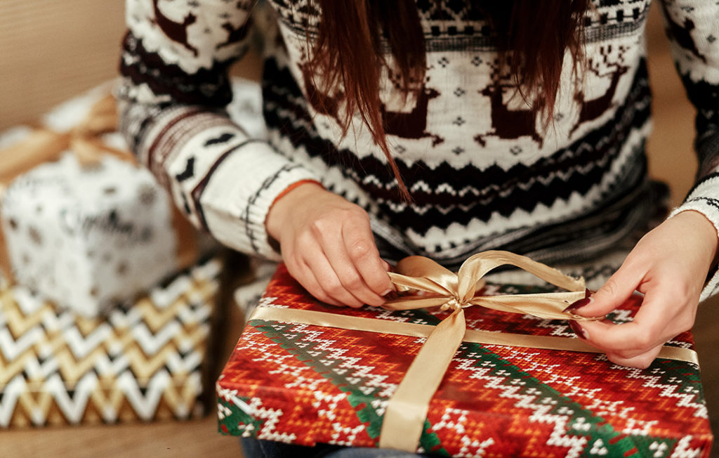 Lady wrapping Xmas parcel Pic: Istockphoto