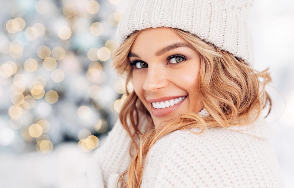 Beautiful woman beside Christmas tree Pic: Istockphoto