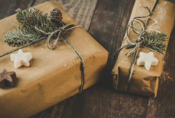 Sustainable gift wrapping idea, presents in brown paper with garden twine and natural pine sprigs