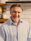Relaxed portrait of chef Raymond Blanc in a kitchen