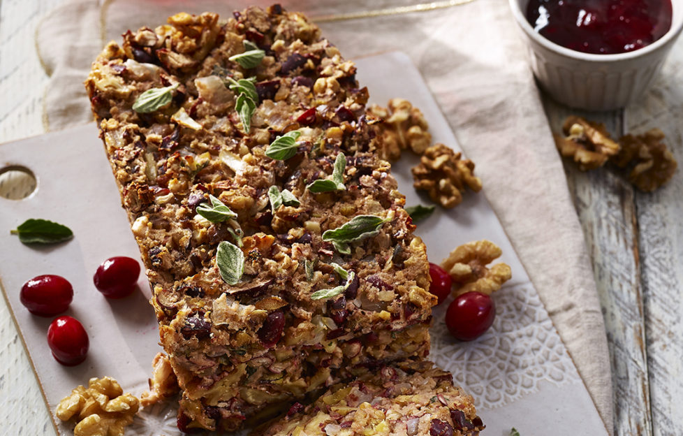 Golden, crumbly nut loaf with cranberries and oregano leaves