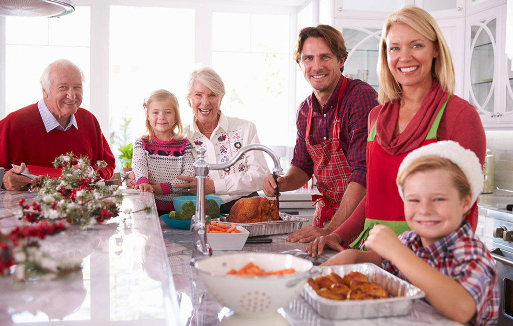 Family in kitchen at Christmas Pic: Shutterstock