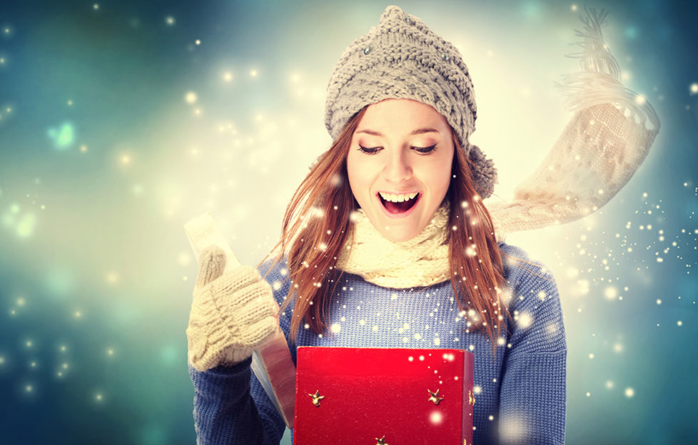 Young lady opening a Christmas present Pic: Shutterstock