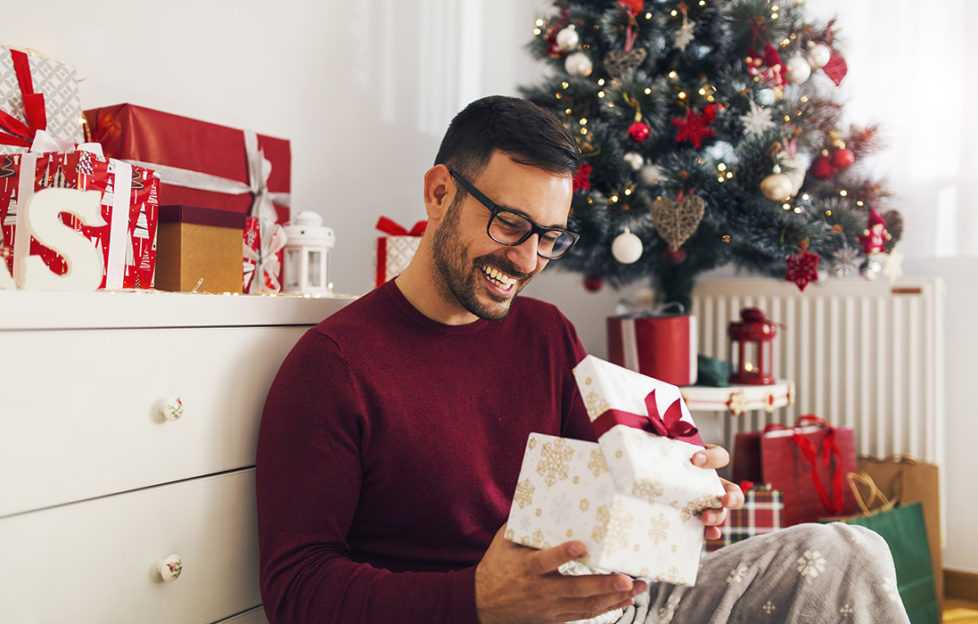 Man opening gift Pic: Shutterstock