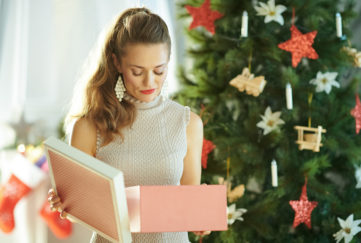 Woman opening present, looking disappointed