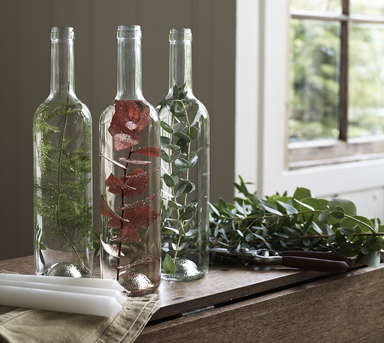 Foliage and water in bottles