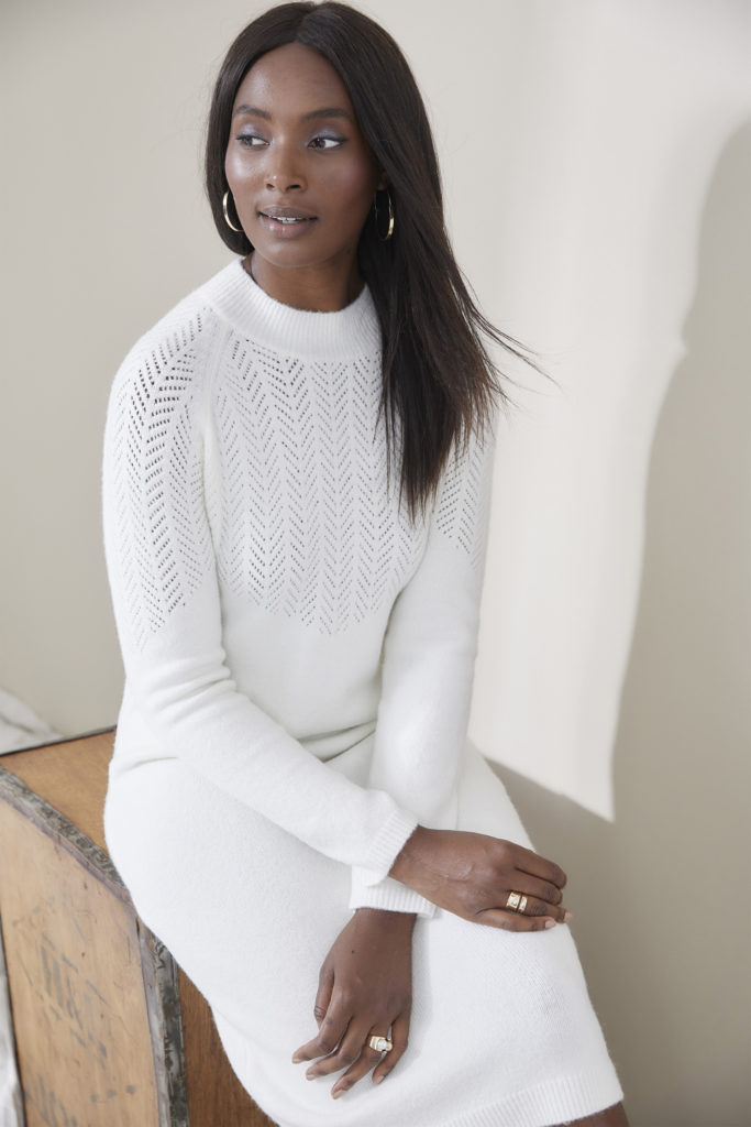 Model in soft white fine knitted jumper dress,