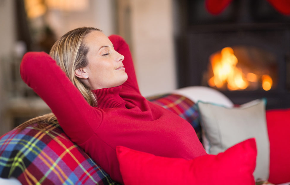 Relaxing on couch at Christmas Pic: Shutterstock