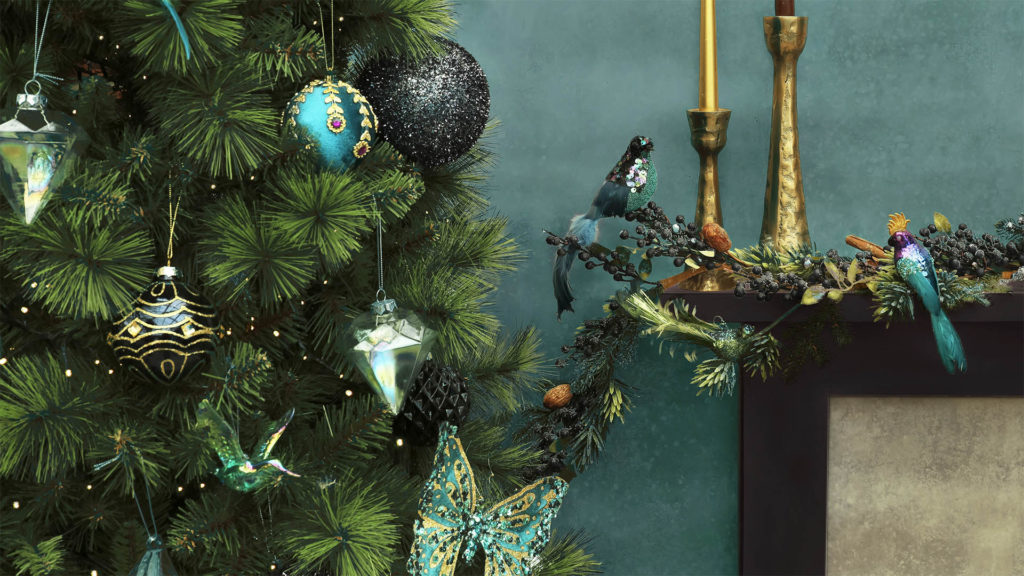 Tree with striking peacock blue and gold decorations, also rustic gold candlesticks and ornate bird ornaments in peacock blue made of feathers and sequins