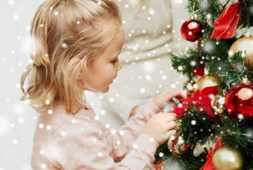 Little girl decorating tree Pic: Shutterstock