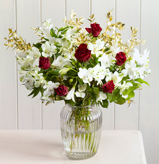 Gorgeous white and red flowers in a vase
