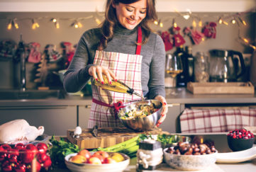 Lady preparing a Christmas dinner with healthy ingredients Pic: Shutterstock
